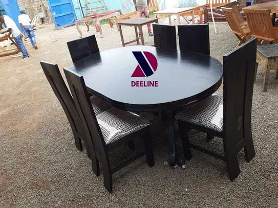 Black oval 6 seater dining table sets image 8