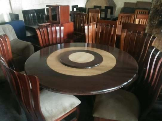 6-seater peacock round dining table with revolver image 1