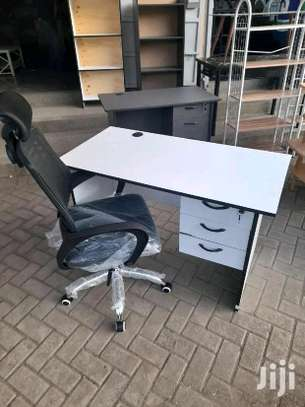White office desk plus a quality black chair in place image 1