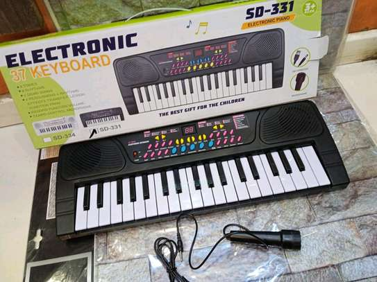 37 keys electric kids keyboard with a microphone image 2