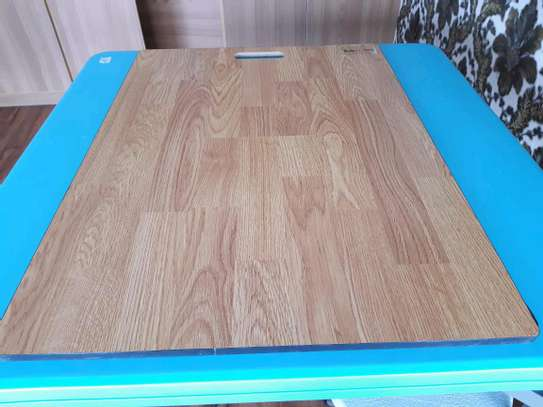 Laminated wooden floor tiles image 2