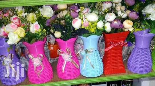 Artificial flowers with vases