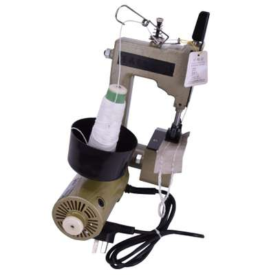Industrial Hand Held Bag closing Machine .