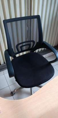 Low back secretarial swivel chair of which is adjustable image 1