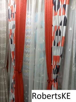 printed orange and white curtain image 1