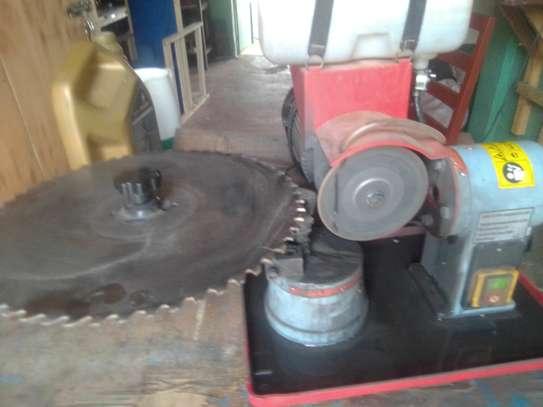 Circular saw blade sharpening machine.