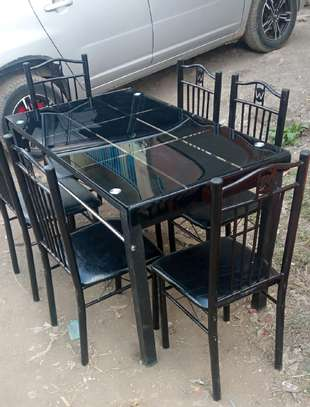 Elegant dining table for six chairs in black image 1