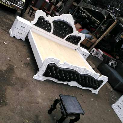5x6 tufted bed with two side tables