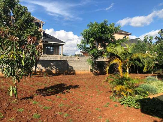 In a compound of three townhouses lies this beautiful four bedrooms all ensuite house image 6