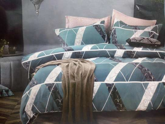 6*6. COTTON BINDED DUVETS WITH 1 BEDSHEET AND 2 PILLOW CASES image 6