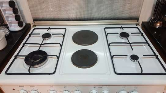 Oven big size with 4gas 2electric burners image 5