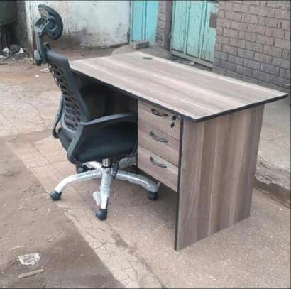 An office desk for everyday use comes with a high back chair image 1