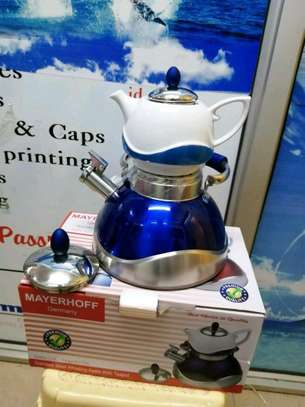 Whistling kettle with detacheable ceramic tea pot