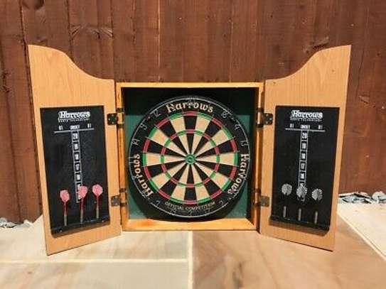 Brand New quality, original Harrows dart board with cabinet.
