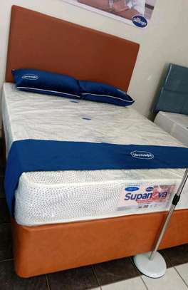 Queen size bed plus spring mattresses ( 5x6)