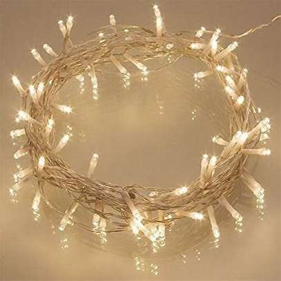 Warm string lights can be used indoors image 1