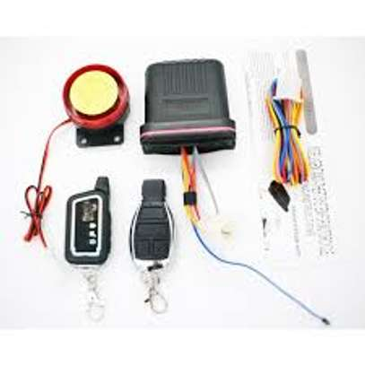 Motorcycle Anti-theft Security Alarm System with Remote Control & Engine Start. image 1