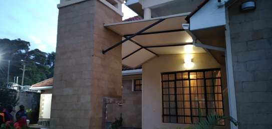 Designs and installation of shades sails canopies car shades etc image 3