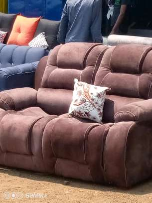 A brown two seater sofa image 1