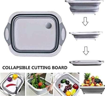 Collapsible chopping board with drainer basket on offer image 1