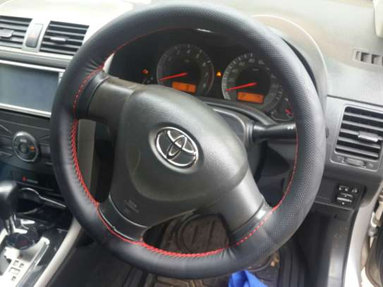 Hand stitched steering wheel cover - leather