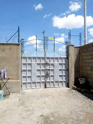 Electric fence installation in Kenya image 2