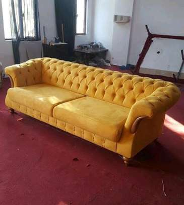 Yellow three seater sofas/chesterfield sofas image 1