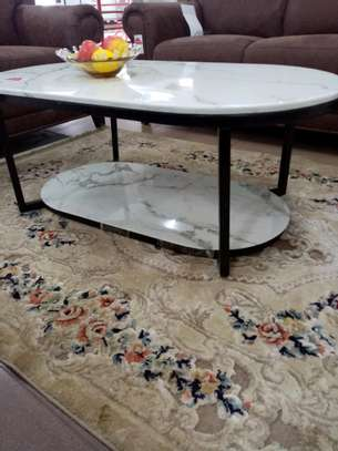 Oval shaped marble coffee table image 1