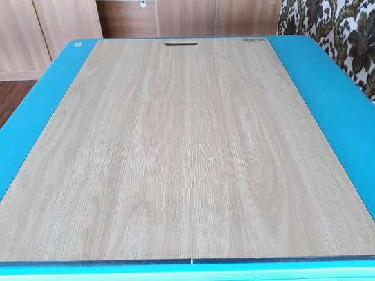 Laminated wooden floor tiles image 4