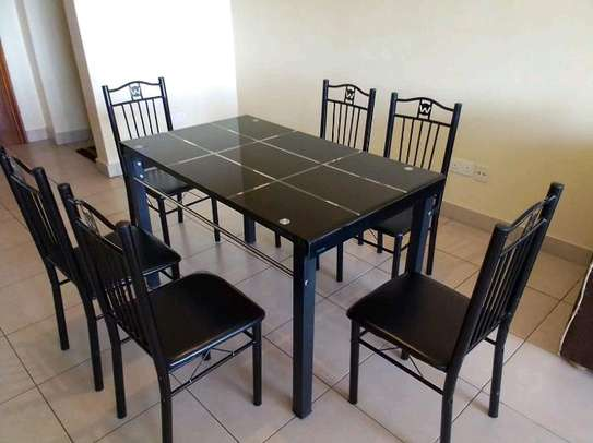 Elegant and classy dining table with chairs image 1