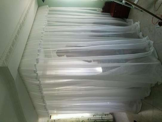 Mosquito Nets Sliding Like Curtains Fixed On The Ceiling image 13