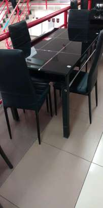 Dining table with extendable seats image 1
