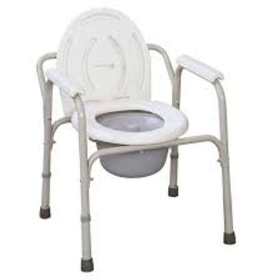 Powder Coated Steel Commode Chair With Plastic Armrests image 1