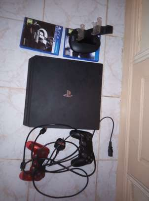 Sony PS 4 Pro with 2 consoles and 2 games