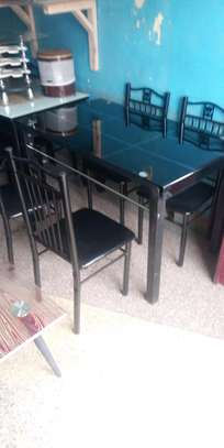 Four legged dining table image 1