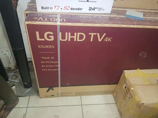 65 LG smart wifi UHD 4k . 2 years