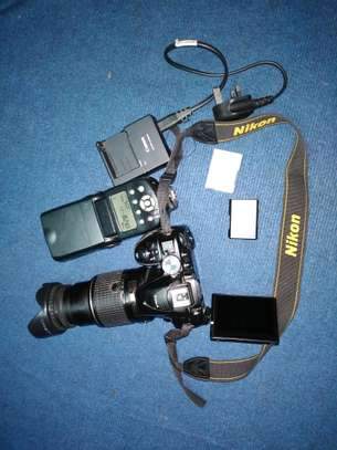 Nikon d5300 with speedlight and two batteries image 1