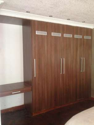 We design and install custom cabinets & wardrobes image 5