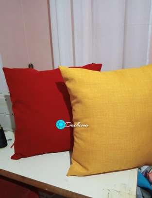 plain red and yellow throw pillows image 1