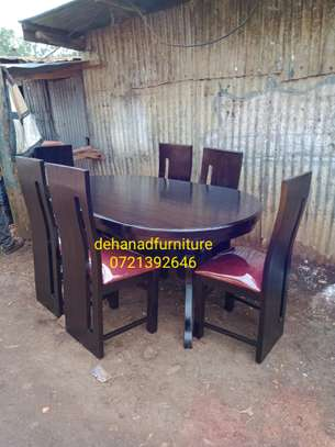 Dark oval solid 6sester dinning table image 1