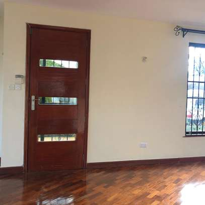 In a compound of three townhouses lies this beautiful four bedrooms all ensuite house image 4