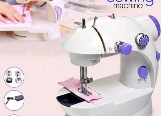 Electric sewing machine with bulb image 1