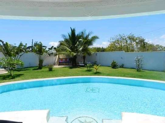 3 bedroom fully furnished own compound image 4