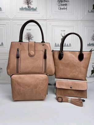 Beige designer handbags image 1