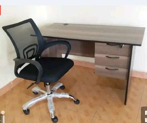 Office work desk combined with an adjustable black swivel chair image 1