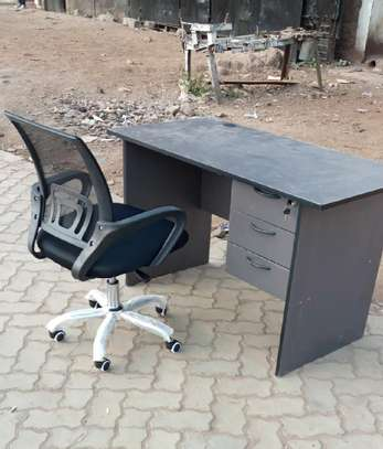 An office desk combined with an office mid back computer ergonomic desk chair image 1