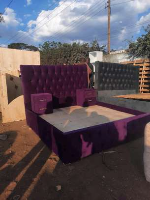 Maroon Chesterfield bed