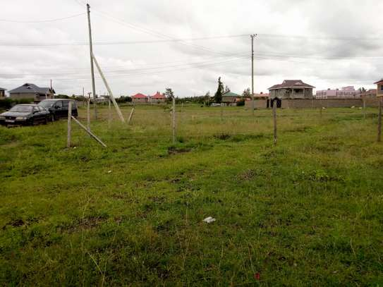 40 by 80, plot in kamulu stage 26,with title deed  approx 200m from the highway.
