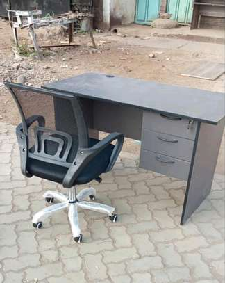 Mesh black chair with an office desk space friendly