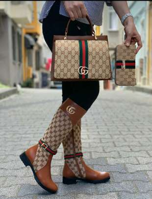 LV BAGS AND THIGH BOOTS image 1